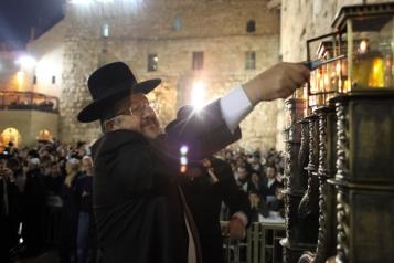 Yehuda Deri (R) , Chief Rabbi of the southern Israeli city of Beersheba and The Western Wall Rabbi Shmuel Rabinovitch (L) light Chanukah candles at the Western Wall in Jerusalem on December 12, 2012. Photo by Yoav Ari Dudkevitch / FLASH90 *** Local Caption *** éäåãä ãøòé äøá øáé ùîåàì øáéðåáéõ çðåëä ëåúì